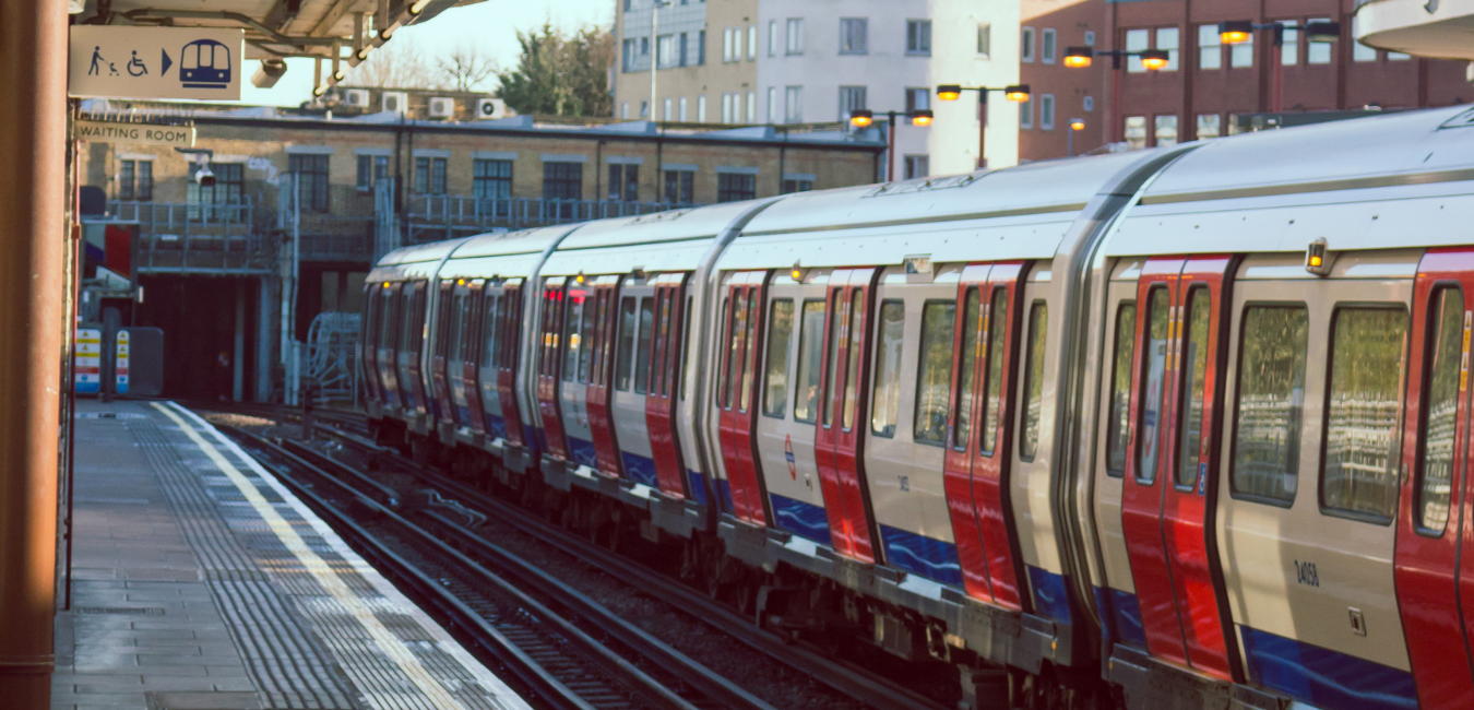 Colourful photograph of a train stopped at an empty station
